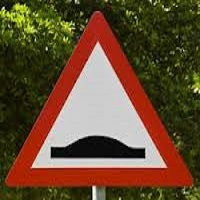 speed bump warning sign